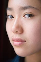 Portrait of teenage girl; looking thoughtful,