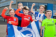 A group of young Brighton fans show their support for the team at the American Express Community Stadium in Brighton during the Sky Bet Championship match between Middlesbrough and Brighton and Hove Albion at the Riverside Stadium, Middlesbrough, England on 7 May 2016. Photo by Bennett Dean.