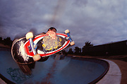 Skateboarder getting air in a pool