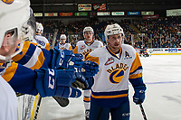 KELOWNA, BC - DECEMBER 01: Max Gerlach #9 and Nolan Kneen #27 of the Saskatoon Blades fist bump the bench to celebrate a goal against the Kelowna Rockets  at Prospera Place on December 1, 2018 in Kelowna, Canada. (Photo by Marissa Baecker/Shoot the Breeze)