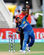 Rangana Herath bowling for Sri Lanka during the ICC Cricket World Cup match between Afghanistan and Sri Lanka at university oval in Dunedin, New Zealand. Photo: Richard Hood/photosport.co.nz