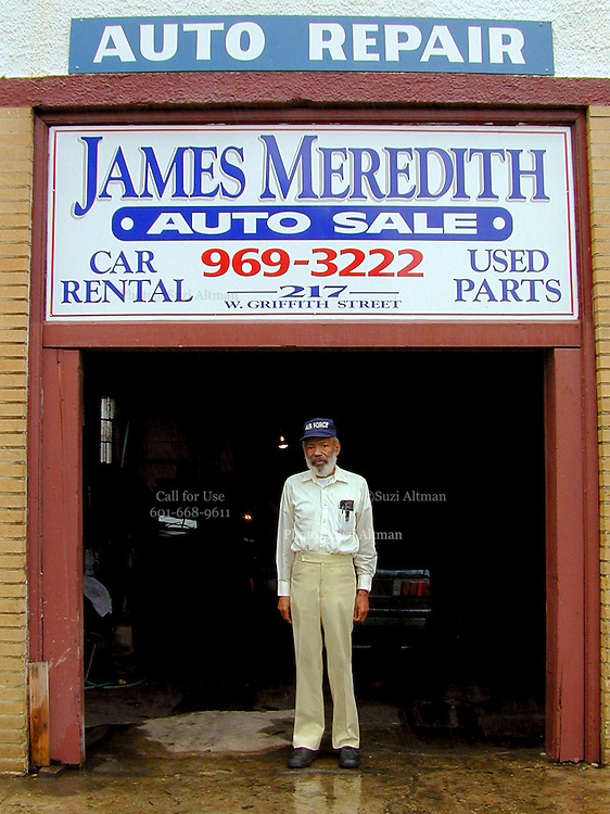 James Meredith,69yrs old, stands outside of his auto repair shop in JacksonMS. Wednesday September 25, 2002, just days before the  40th anniversary of desegregation on the campus of Olde Miss University in Oxford,MS. James Meredith was the first african american student enrolled at the university. He later went on to law school at columbia university in New york city.Trent Lott was asenior at Olde Miss when riots broke uot to protest desegreation of campus.(Photo Suzi Altman)