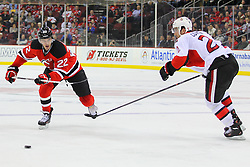Dec 18, 2013; Newark, NJ, USA;  New Jersey Devils defenseman Eric Gelinas (22) and Ottawa Senators right wing Erik Condra (22) race for the loose puck during the second period at the Prudential Center.