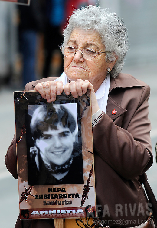 An elder Basque woman holds a placard with a photograph of an imprisoned member of Basque separatist terrorist group ETA, during a demonstration demanding freedom for the Basque Country, on May 17, 2008 in the northern Spanish Basque city of Bilbao. PHOTO Rafa RIVAS