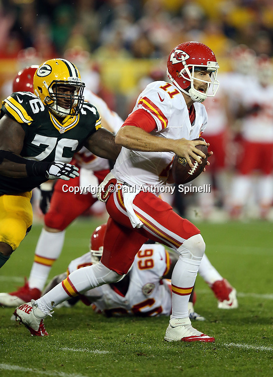 Green Bay Packers defensive end Mike Daniels (76) closes in on Kansas City Chiefs quarterback Alex Smith (11) from behind on a third quarter sack split with Green Bay Packers outside linebacker Mike Neal (96) during the 2015 NFL week 3 regular season football game against the Kansas City Chiefs on Monday, Sept. 28, 2015 in Green Bay, Wis. The Packers won the game 38-28. (©Paul Anthony Spinelli)