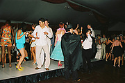 Making shapes on the dancefloor amongst the costumed guests, Posh at Addington Palace, UK, August, 2004