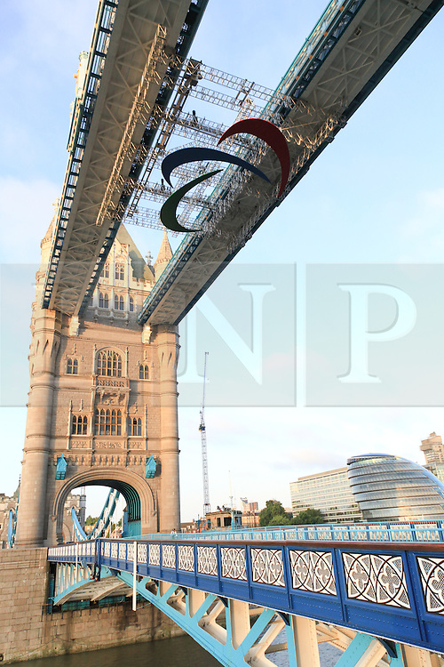© Licensed to London News Pictures. 22/08/2012. London, UK. Paralympic Agitos installed on Tower Bridge in London. From 24 August the giant set of red, blue and green Agitos, the symbol for the 2012 Paralympic Games will hang from Tower Bridge. Photo credit : Vickie Flores/LNP