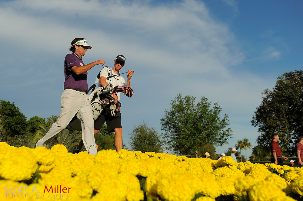 Bubba Watson and his caddie Ted Scott during the third round of the World Golf Championship Cadillac Championship on the TPC Blue Monster Course at Doral Golf Resort And Spa on March 10, 2012 in Doral, Fla. ..©2012 Scott A. Miller.
