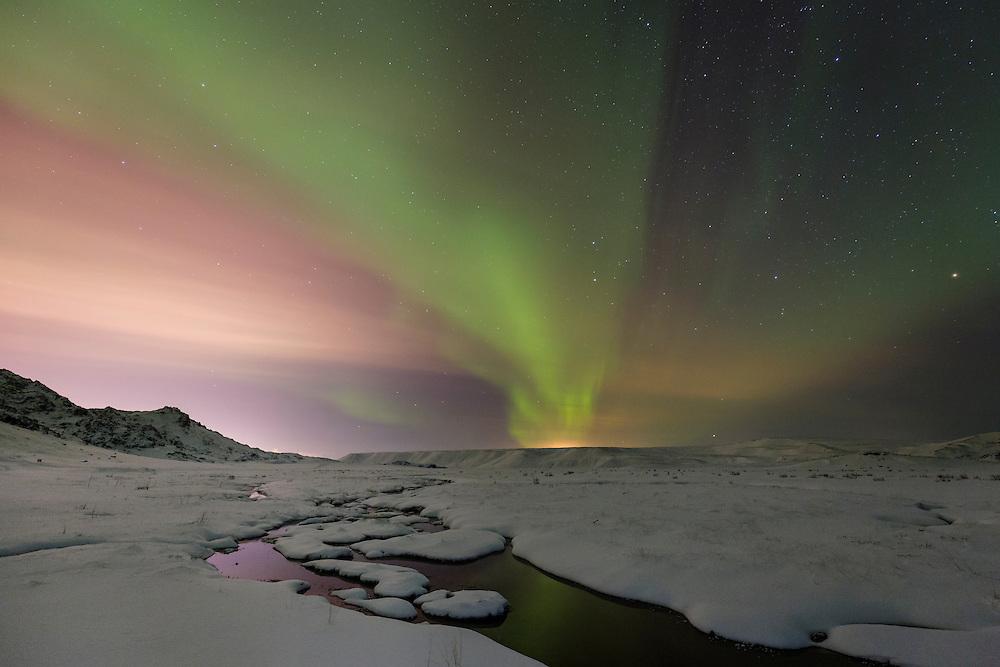 Aurora Borealis over snowy landscape in Iceland