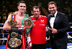 Callum Smith (left) celebrates with trainer Joe Gallagher and promoter Eddie Hearn (right) after winning the WBA 'Super' World, WBC Diamond, Ring Magazine Super-Middleweight title match at Madison Square Garden, New York.