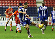 Wigan Defender Jason Pearce during the Sky Bet League 1 match between Wigan Athletic and Blackpool at the DW Stadium, Wigan, England on 12 December 2015. Photo by Pete Burns.