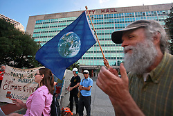 22 April 2014. New Orleans, Louisiana. <br /> A small group of protesters with Global Climate Convergence hold a rally outside City Hall on Earth Day to promote awareness for their cause for 'People - Planet - Peace over Profit.'<br /> Photo; Charlie Varley/varleypix.com