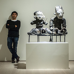 London, UK - 2 September 2014: Artist Xavier Mascaró poses next to his work 'Sacred Couple'. Xavier Mascaró's first UK solo exhibition will run from 3 September until 5 October at Saatchi Gallery.