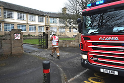 Pictured: Penicuik High School pupils and staff evacuated from the school.<br /> Day one of the Higher and Advanced Highers for Penicuik High School students was disturbed by a small fire in a class room. While minimal damage was doen and no injuries sustained, the school had to be evacuarted and checked by the fire service. There tenders attended the emergency.<br /> <br /> <br /> <br /> Ger Harley | EEm 5 May 2016