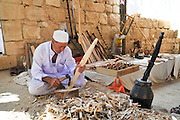 Israel, Negev Desert, Mamshit the Nabataean city of Memphis, re-enactment on the life in the Nabatean period re-enactment of the marketplace with stalls selling products similar to those used in the Nabataean era. Carpenter using primitive methods to shape wood