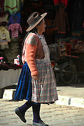 Campesino woman walking to the market in Tarabuco, Chuquisaca, Bolivia