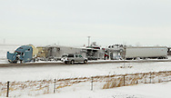 A vehicle drives by a three semi truck accident in the median along Interstate 80 in Polk County in Iowa on Wednesday February 2, 2011.