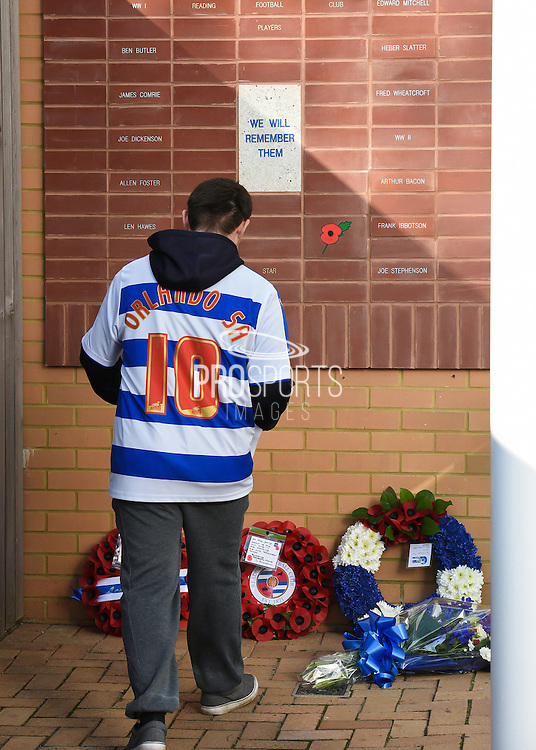 A Reading fan lays a wreath at the Remembrance Service in memory of those who have lost their lives in the line of duty before the Sky Bet Championship match between Reading and Brighton and Hove Albion at the Madejski Stadium, Reading, England on 31 October 2015. Photo by David Charbit.