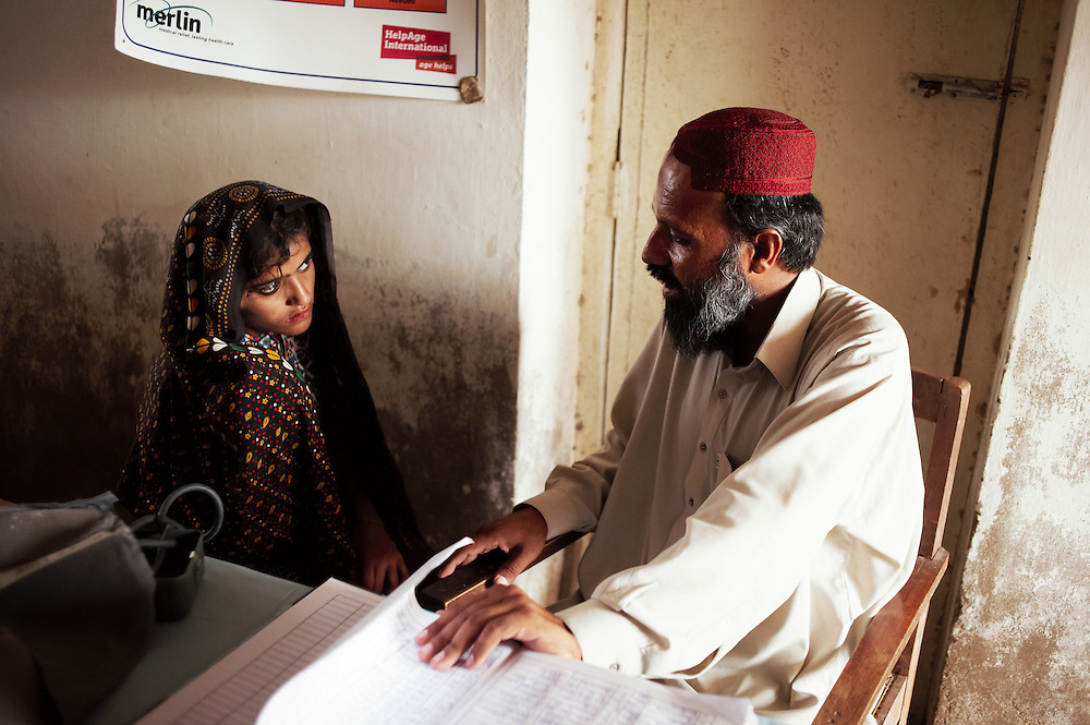 Merlin doctor Muneer treats a patient at the Government Health Clinic in the village of Babrio Jat, Thatta, Sindh, Pakistan on July 2, 2011.