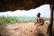 LUOYANG, CHINA - (CHINA OUT) <br /> <br /> A Blind Mental Patient Is Shackled In A Cave For One Year<br /> <br /> Blind mental patient Cheng Xiangtao, 26, is tethered by an iron chain at a cave on August 27, 2013 in Luoyang, Henan Province of China. Cheng Xiangtao was born blind. And family members found him to be insane when Cheng grew up. He never wears clothes and always hung around the village. Other villagers had a lot of complaints about the behaviour. His father had to tether him to a cave last year, and send him food every day.  <br /> ©Exclusivepix