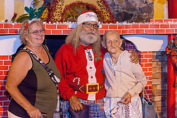(L-R) Noreen Aubain, take a picture together in front of the Christmas trees.   Jesus Daniel Tolentino Rivera Cruz, and Elizabeth Aubain.  Frenchtown Civic Organization/French Heritage Museum presents its 3rd Annual Festival of Lights Christmas Tree Competition in Frenchtown.  St. Thomas, USVI.  11 December 2016.  © Aisha-Zakiya Boyd