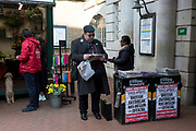 On the day that the UK Government's Chief Scientific Advisor, Sir Patrick Vallance said that the Coronavirus Covid-19 outbreak was now spreading person to person in the UK, a Londoner reads the latest news headline from the capital's London Evening Standard newspaper is seen outside Embankment underground station, on 6th March 2020, in London, England.
