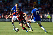 Ryan Fraser (24) of AFC Bournemouth on the attack goes past Alex Iwobi (17) of Everton during the Premier League match between Bournemouth and Everton at the Vitality Stadium, Bournemouth, England on 15 September 2019.