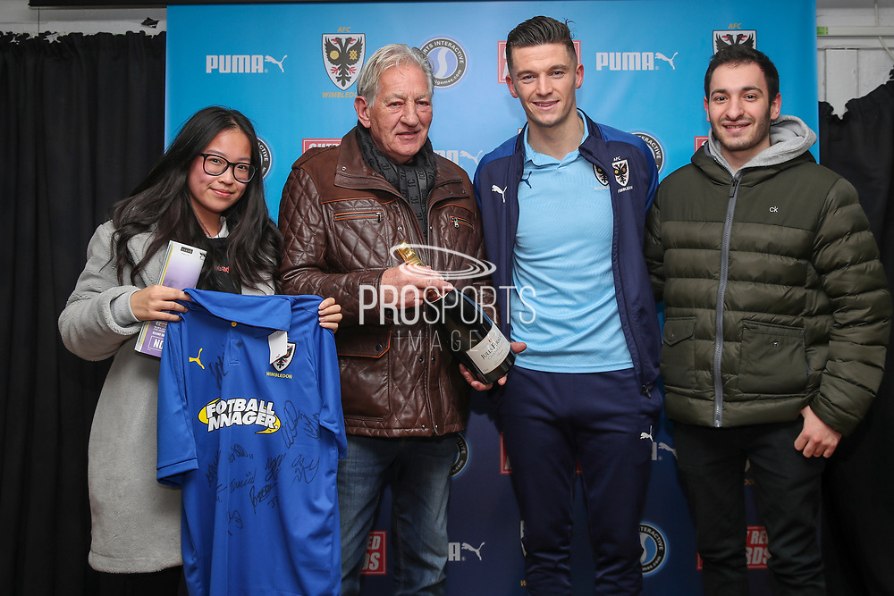 AFC Wimbledon midfielder Callum Reilly (33) receiving man of match award during the EFL Sky Bet League 1 match between AFC Wimbledon and Southend United at the Cherry Red Records Stadium, Kingston, England on 1 January 2020.