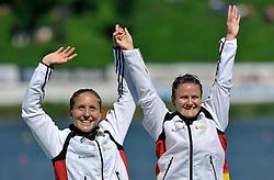 CAROLIN LEONHARDT & SILKE HOERMANN (BOTH GERMANY) CELEBRATE THEIR SILVER MEDALS IN WOMEN'S K2 1000 METERS FINAL A RACE DURING 2010 ICF KAYAK SPRINT WORLD CHAMPIONSHIPS ON MALTA LAKE IN POZNAN, POLAND...POLAND , POZNAN , AUGUST 21, 2010..( PHOTO BY ADAM NURKIEWICZ / MEDIASPORT ).