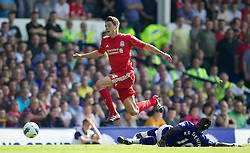 LIVERPOOL, ENGLAND - Saturday, October 1, 2011: Liverpool's Martin Kelly in action against Everton's Royston Drenthe during the Premiership match at Goodison Park. (Pic by Vegard Grott/Propaganda)