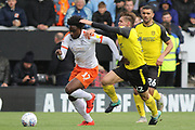 Burton Albion midfielder Ben Fox challenges Luton Town midfielder Pelly Ruddock during the EFL Sky Bet League 1 match between Burton Albion and Luton Town at the Pirelli Stadium, Burton upon Trent, England on 27 April 2019.