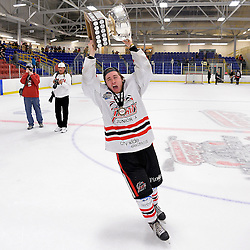 FORT FRANCES, ON - May 2, 2015 : Central Canadian Junior &quot;A&quot; Championship, game action between the Fort Frances Lakers and the Soo Thunderbirds, Championship game of the Dudley Hewitt Cup. Eric Hillock #26 of the Soo Thunderbirds raises the Dudley Hewitt Cup.<br /> (Photo by Shawn Muir / OJHL Images)