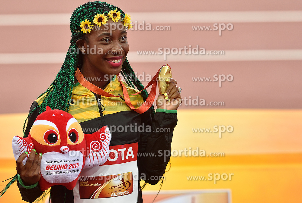 25-08-2015 CHN: IAAF World Championships Athletics day 4, Beijing<br /> Winner Shelly-Ann Frase-Pryce (JAM)  celebrates at 100 m Women medal ceremony. <br /> Photo by Ronald Hoogendoorn / Sportida