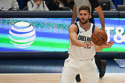 Dallas Mavericks power forward Maxi Kleber (42) passes the ball against the Toronto Raptors during an NBA basketball game, Saturday, Nov. 16, 2019, in Dallas. The Mavericks defeated the Raptors 110-102. (Wayne Gooden/Image of Sport)