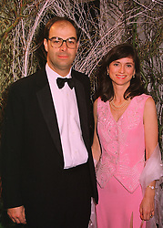 VISCOUNT & VISCOUNTESS MACKINTOSH OF HALIFAX, at a ball in London on 21st May 1998.MHW 11