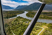 Aerial view of Martins Bay Lodge on the Hollyford River in Fiordland National Park. We flew from Milford Sound to Martins Bay to start the Hollyford Track, in Southland region, South Island of New Zealand. We enjoyed an easy 3-day version of the Hollyford Track: Day 1: fly from Milford Sound to Martins Bay, walk to its oceanfront Hut, and see New Zealand fur seals. Day 2: jetboat on Lake McKerrow to Pyke River Confluence, hike to Hidden Falls Hut for overnight lodging. Day 3: tramp out to Hollyford Road end to our prearranged car shuttle. In 1990, UNESCO honored Te Wahipounamu - South West New Zealand as a World Heritage Area.