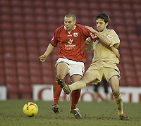 Photo: Aidan Ellis.<br /> Barnsley v Bristol City. Coca Cola League 1. 04/02/2006.<br /> Bristol's Cole Skuse challenges Barnsley's Marc Richards