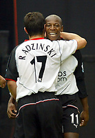 25/9/2004<br />FA Barclays Premiership - Fulham v Southampton - Craven Cottage<br />Fulham's Tomasz Radzinski celebrates with team mate Luis Boa Morte who supplied the cross for Radzinski to score with a header.<br />Photo:Jed Leicester/BPI (back page images)