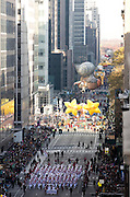 Balloons float down 6th Avenue for the 89th annual Macy's Thanksgiving Day Parade as seen from above street level on Thursday, Nov. 26, 2015, in New York. (Photo by Ben Hider/Invision/AP)