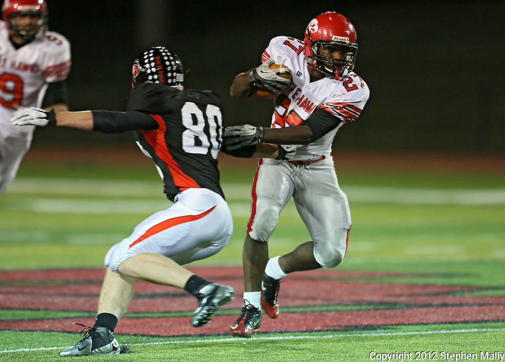 Iowa City High's Xavier Washpun (27) avoids Linn-Mar's Jon Schlotterback (80) on a run during during the game between the Iowa City High Little Hawks and the Linn-Mar Lions at Linn-Mar Stadium in Marion on Friday October 12, 2012.