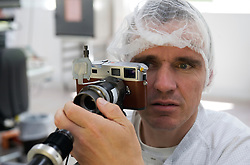 SOLMS, GERMANY - MAY-18-2009 - Leica technicians put every camera through a battery of rigorous tests, checking every system of the camera, including shutter timing, range finder and focusing system accuracy, the sensitivity and consistency of the CCD, etc. etc. etc...(Photo © Jock Fistick)
