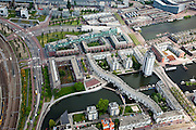 Nederland, Amsterdam, Oostelijk Havengebied,  25-05-2010. De (voormalige) Rietlanden met het gebouw Entrepotbrug en inghang van de Piet Heintunnel (boven in beeld)..Former Eastern Docklands.luchtfoto (toeslag), aerial photo (additional fee required).foto/photo Siebe Swart