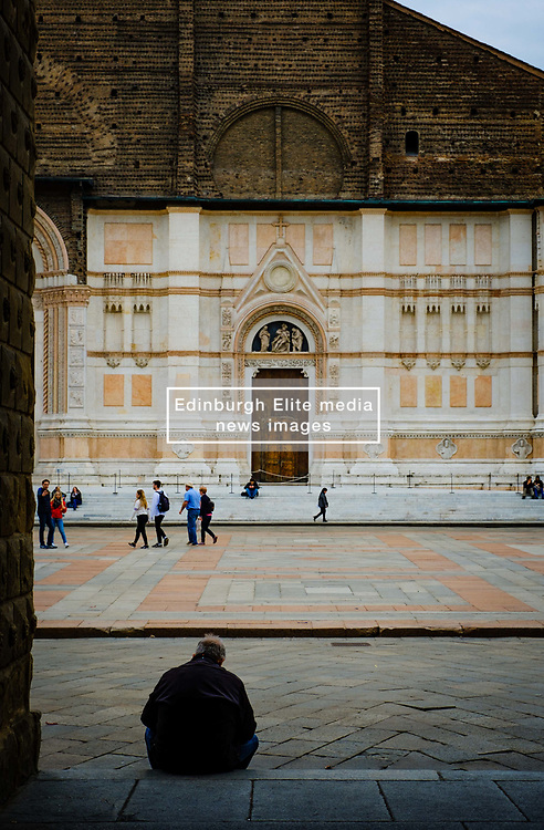 Sitting on steps in the Piazza Maggiore looking towards the Basilica di San Petronio, Bologna, Italy<br /> <br /> (c) Andrew Wilson | Edinburgh Elite media
