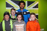 Forest Green Rovers Reuben Reid(26) with ambassadors during the EFL Sky Bet League 2 match between Forest Green Rovers and Mansfield Town at the New Lawn, Forest Green, United Kingdom on 24 March 2018. Picture by Shane Healey.
