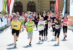School Runners at finish line during running race 12 km and 29 km Tek trojk et event Pot ob zici, on May 10, 2014, at Kongresni trg in Ljubljana, Slovenia. Photo by Vid Ponikvar / Sportida