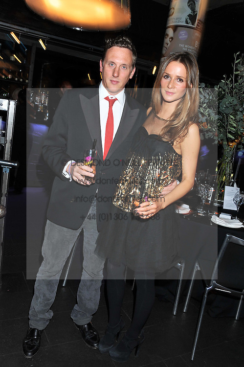 HARRY BECHER and AMANDA CROSSLEY at the Wild for WSPA dinner in aid of the charity World Society for the Protection of Animals held at Under The Bridge, Stamford Bridge, Fulham Road, London on 23rd February 2012.