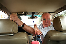 British journalist Robert Fisk rides in a car while on assignment in Lebanon, Beirut on March 25, 2008. Frisk is famous for his coverage of Beirut's 15 year civil war. His new book is The Age of the Warrior: Selected Essays by Robert Fisk, a collection of his Saturday columns for the British newspaper The Independent.