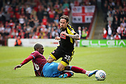 Scunthorpe United's Funso Ojo (6) tackles Rotherham United midfielder Ryan Williams (23) during the EFL Sky Bet League 1 match between Scunthorpe United and Rotherham United at Glanford Park, Scunthorpe, England on 12 May 2018. Picture by Nigel Cole.