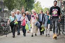 23 August 2018, Amsterdam, Netherlands: A ìWalk of Peaceî on 23 August in Amsterdam gathers hundreds of young people and religious leaders who, as they stroll together, celebrating the ecumenical movement and challenging each other to accomplish even more. The walk offers moments of reflection and prayer at several houses and buildings - including a synagogue, the Santí Egidio Community, the Armenian Church, and many others - all of which carried stories of blessings, wounds and transformation.