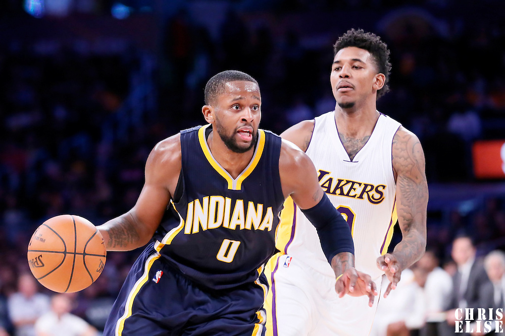 04 January 2014: Indiana Pacers guard C.J. Miles (0) drives past Los Angeles Lakers forward Nick Young (0) during the Los Angeles Lakers 88-87 victory over the Indiana Pacers, at the Staples Center, Los Angeles, California, USA.